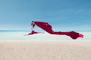 http://www.dreamstime.com/royalty-free-stock-image-amazing-dance-red-flag-beach-female-dancer-image31641336